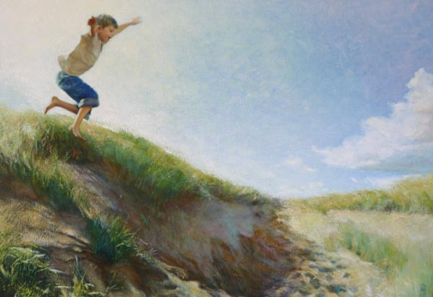 Portrait of Ollie Spencer jumping from the dune on Camber Sands.